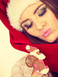 Woman santa claus hat with gingerbread cookie. Christmas Royalty Free Stock Images