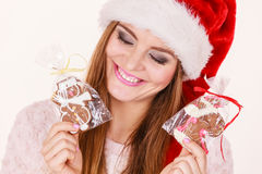 Woman santa claus hat with gingerbread cookies. Christmas Royalty Free Stock Photos