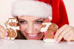 Woman santa claus hat with gingerbread cookies. Christmas Stock Images