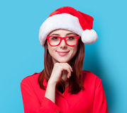 Woman in Santa Claus hat and glasses Stock Photos