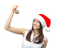 Woman in santa claus hat hold christmas ball Stock Image
