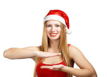 Woman in santa claus hat holding something in hands. Smiling young woman in santa claus hat gesturing like holding something in hands isolated on white Stock Image