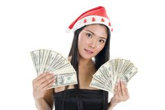 Woman with santa claus hat and money Stock Image
