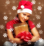 Woman in santa claus hat with present in hands Royalty Free Stock Photo