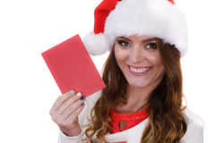 Woman in santa claus hat reading letter Stock Photography