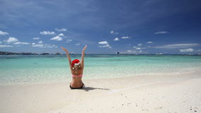 Woman in Santa Claus hat sitting on tropical beach. Boracay, Philippines stock footage