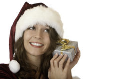 Woman Santa Claus holding christmas present Stock Photography