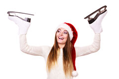 Woman santa claus with ice skates Royalty Free Stock Image