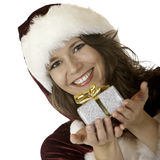 Woman Santa Claus smiling with christmas present Stock Photo