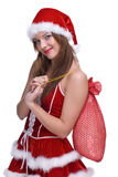Woman in santa clause dress and gifts bag Royalty Free Stock Photo