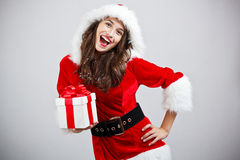 Woman in Santa cloth Stock Photo