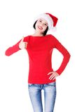 Woman in santa clothes gesturing thumbs up Royalty Free Stock Image