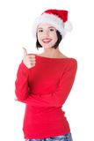 Woman in santa clothes gesturing thumbs up Stock Image