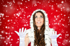 Woman in santa clothes standing in the snow Royalty Free Stock Image