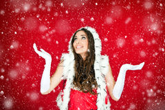 Woman in santa clothes standing in the snow Stock Photography