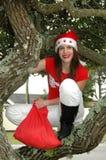 Woman in Santa costume stock image