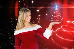 Woman in santa costume gesturing against digitally generated background Royalty Free Stock Photography