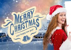 Woman in santa costume holding blank placard 3D. Woman in santa costume holding blank placard against 3D digitally generated christmas background Stock Photography