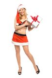 Woman in Santa costume holding gift Royalty Free Stock Photography