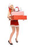 Woman in Santa costume holding gifts royalty free stock image