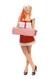 Woman in Santa costume holding gifts Royalty Free Stock Photo