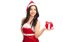 Woman in Santa costume holding a present Royalty Free Stock Image