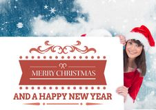 Woman in santa costume peeking out of a poster Stock Image