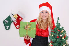 Woman in santa costume with presents Royalty Free Stock Photography
