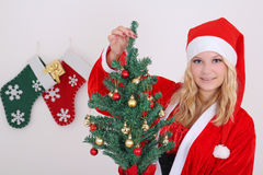 Woman in santa costume with presents Stock Photo