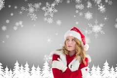 Woman in santa costume shivering with cold Royalty Free Stock Photos
