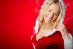 Woman in Santa costume waiting for New Year celebration. Happy woman in Santa costume waiting for New Year celebration Stock Photo