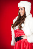 Woman in santa costume and white hat Royalty Free Stock Photos