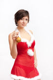 Woman in santa dress with christmas ball Royalty Free Stock Photos
