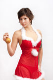 Woman in santa dress with christmas ball Stock Photos