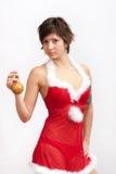 Woman in santa dress with christmas ball stock photos