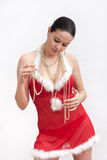 Woman in santa dress with christmas ball Stock Photo