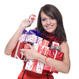 Woman in santa dress with gifts. Emotional playful woman  in santa claus dress, white fur and some gifts Stock Images