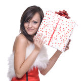 Woman in santa dress with gifts. Emotional playful woman  in santa claus dress, white fur and some gifts Royalty Free Stock Image