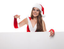 Woman in santa dress and hat with an empty billboard on a white Royalty Free Stock Images