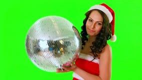 Woman in Santa dress keep disco ball. Green background. stock video