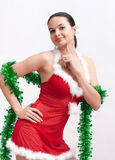 Woman in santa dress with spangle Stock Images