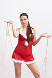 Woman in santa dress with spangle Stock Photo