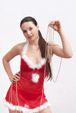 Woman in santa dress with spangle stock image
