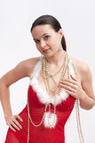 Woman in santa dress with spangle Royalty Free Stock Images
