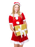 Woman with santa dressing and holding present box Royalty Free Stock Photos