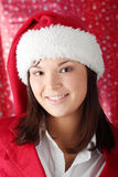 Woman in santa hat Stock Photography