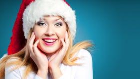 Woman in Santa hat. Joyful shocked woman in Santa hat, copyspace royalty free stock images