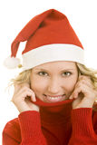 Woman in Santa hat. Portrait of young blond woman in red turtleneck sweater and Santa hat, white background stock photo