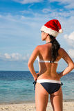 Woman in santa hat on the beach Stock Photography