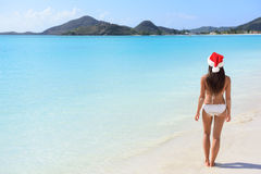 Woman in Santa hat on beach travel vacation Stock Photos